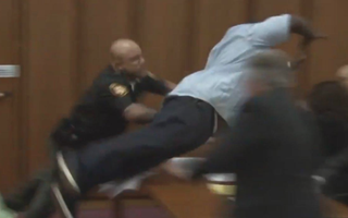 Van Terry, the father of  Shirellda Terry, dives across a courtroom table in Cleveland on June 2, 2016, to attack serial killer Michael Madison, who was convicted of murdering Shirellda Terry and two other women.Fox 8 screenshot