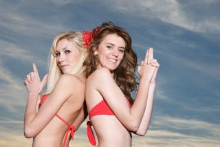 """Illustration for article titled """"Peace"""" Officers Suspended After Supervising Gun-Happy Bikini Shoot"""