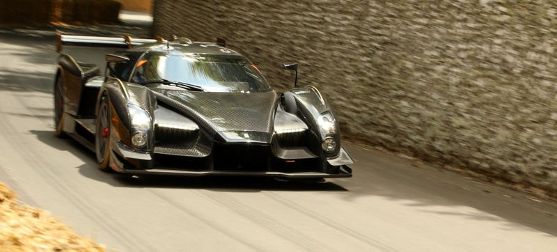 Illustration for article titled Listen To The Wild SCG 003 As It Runs Up The Goodwood Hill