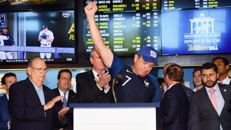 Raymond Lesniak celebrates at a news conference before the start of sports gambling in New Jersey.