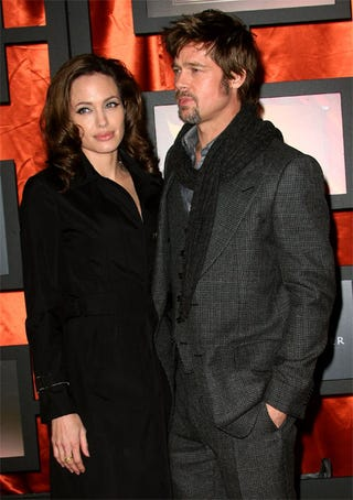 Illustration for article titled Brad & Angelina's Matching Haircolor, Nonplussed Pouts