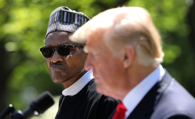 Nigerian President Muhammadu Buhari listens to U.S. president and unindicted co-conspirator Donald Trump at the White House on April 30, 2018