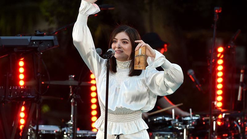Lorde holding a mousetrap.
