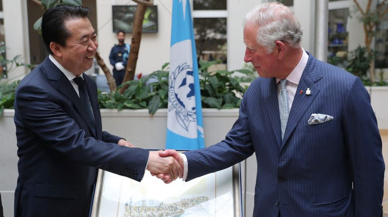 LYON, FRANCE - MAY 07: The Prince of Wales shakes hands with Interpol President Meng Hongwei during his tour of Interpol as part of his visit to France on May 8th, 2018 in Lyon, France.