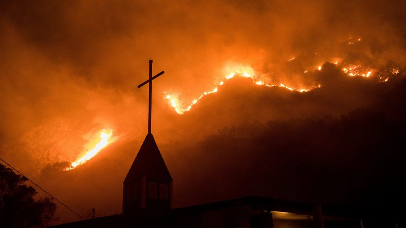 Flames from a wildfire advance down a hillside near the Springs of Life Church in Casitas Springs, CA, on Tuesday, Dec. 5, 2017. (Image: AP)