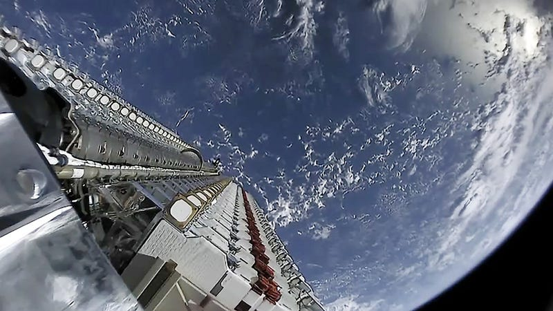 The first batch of 60 Starlink satellites just prior to deployment in low Earth orbit.