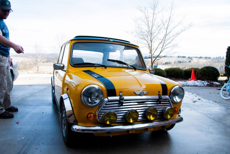 This is the day I went to purchase my Mini two years ago to the date. It's also the same day I learned what a tire blow out on the interstate felt like. Ed (to the left), former owner. Jay, best friend, (checking the left rear tire pressure before departing). The suspect Tire (un-shown, lost all pressure and will to live at 70 miles an hour, God speed).