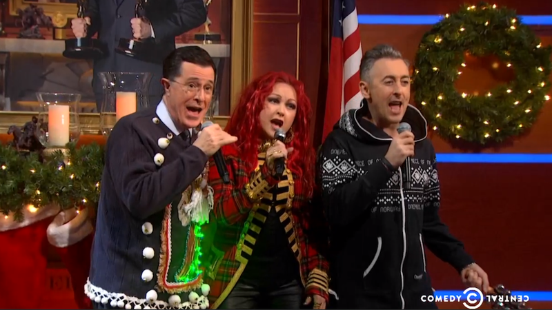 Illustration for article titled Colbert, Cyndi Lauper and Alan Cumming Adorably Sang Carols Last Night