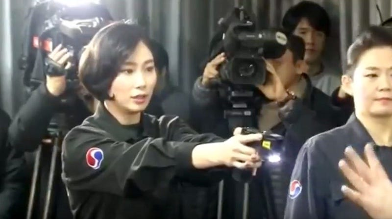 Korean Air crew members being trained on the use of stun guns during a media event (Screenshot via YouTube)