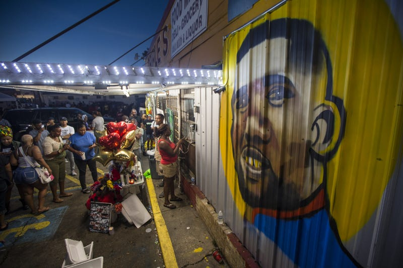 Protesters gather July 6, 2016, in front of a mural painted on the wall of the Triple S Food Mart convenience store in Baton Rouge, La., where Alton Sterling was shot and killed July 5, 2016.Mark Wallheiser/Getty Images
