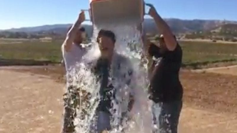 You can't tell, but that's Nick Offerman getting doused with ice water (Screengrab: Offerman Woodshop/Facebook)