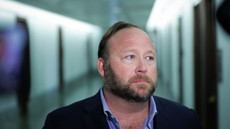 WASHINGTON, DC - SEPTEMBER 5: Alex Jones of InfoWars talks to reporters outside a Senate Intelligence Committee hearing concerning foreign influence operations' use of social media platforms, on Capitol Hill, September 5, 2018 in Washington, DC. Twitter CEO Jack Dorsey and Facebook chief operating officer Sheryl Sandberg faced questions about how foreign operatives use their platforms in attempts to influence and manipulate public opinion.