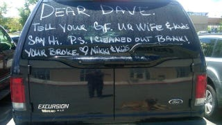 Illustration for article titled Wife paints news of hubby's affair on SUV rear window