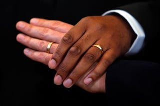 A couple hold hands after their wedding ceremony in Washington, D.C., on March 9, 2010, in Washington, D.C. Alex Wong/Getty Images