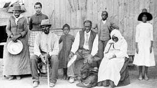 """Harriet Tubman (circa 1820-1913) with family and neighbors circa 1887 at her home in Auburn, N.Y. From left: Harriet Tubman; Gertie Davis (Watson); Nelson Davis, Gertie's husband; Lee Chaney, a neighbor's child; """"Pop"""" John Alexander, an elderly boarder in Tubman's home; Walter Green, a neighbor's child; Blind """"Aunty"""" Sarah Parker, an elderly boarder; and Dora Stewart, great-niece and granddaughter of Tubman's brother Robert.Wikimedia Commons"""