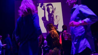 Guests dance to Prince music as a slideshow flashes images of the artist above the stage during a memorial dance party at the First Avenue nightclub in Minneapolis on April 21, 2016.Scott Olson/Getty Images