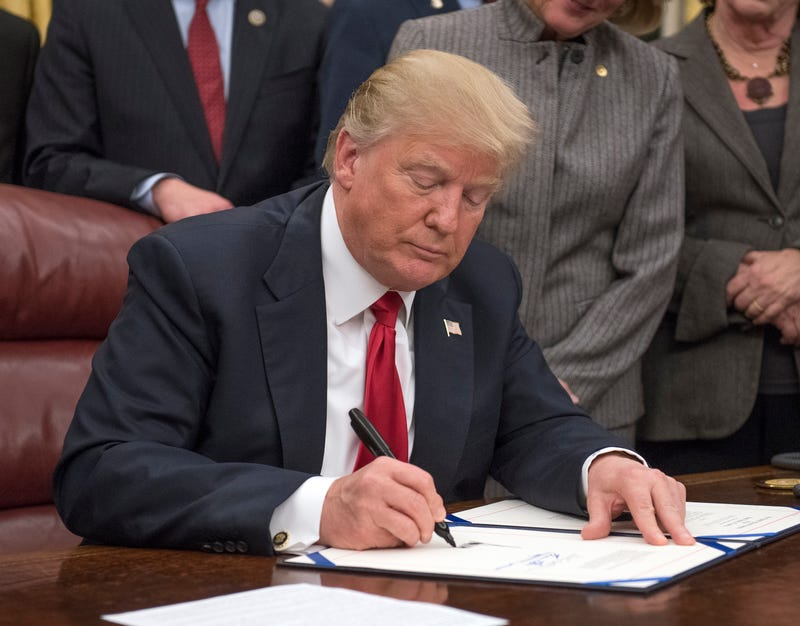 President Donald Trump signs a bipartisan bill to stop the flow of opioids into the United States in the Oval Office of the White House on Jan. 10, 2018, in Washington, D.C.
