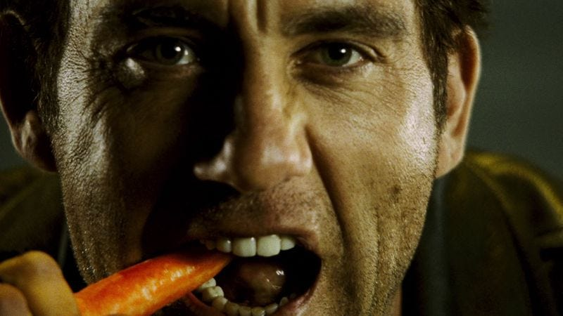 Illustration for article titled Clive Owen is a gun-toting Bugs Bunny, carrot and all
