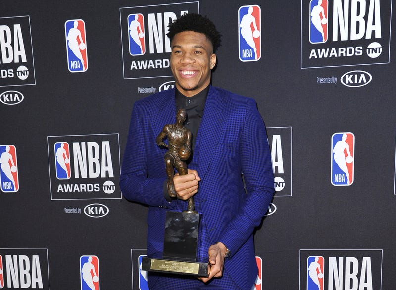 NBA player Giannis Antetokounmpo, of the Milwaukee Bucks, poses in the press room with most valuable player award at the NBA Awards on Monday, June 24, 2019, at the Barker Hangar in Santa Monica, Calif.