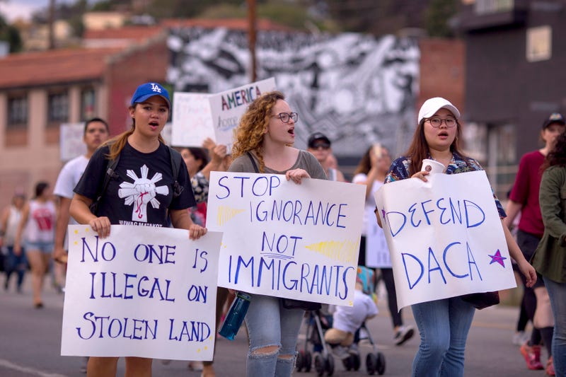 Immigrants and supporters at the Defend DACA March on Sept. 10, 2017, in Los Angeles to oppose President Donald Trump's order to end the Barack Obama-era Deferred Action for Childhood Arrivals program. Congress has the option to replace the policy with legislation before DACA expires on March 5, 2018. (David McNew/Getty Images)