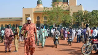 People leave the Grand Mosque of Niamey on May 1, 2015, after a collective prayer for the victims of an April 25, 2015, attack by Boko Haram Islamists on Karamga Island on Lake Chad, which left at least 74 dead. BOUREIMA HAMA/Getty Images