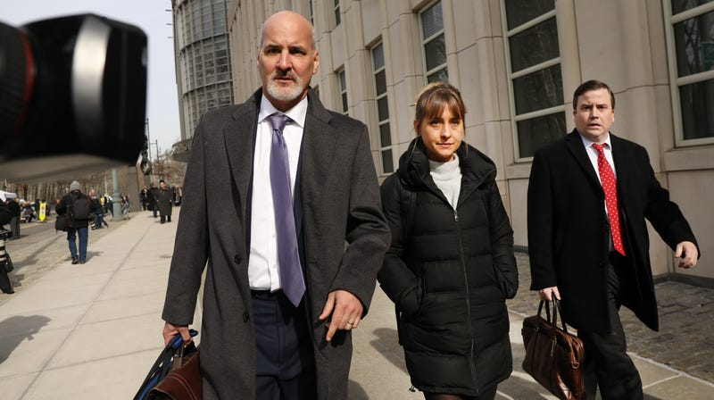 Actress Allison Mack leaves the Brooklyn Federal Courthouse with her lawyers after a court appearance surrounding the alleged sex cult NXIVM on February 06, 2019 in New York City.