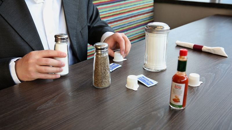 Illustration for article titled Report: Majority Of Diner's Salt And Pepper Shakers Currently Being Used To Diagram Elaborately Planned Bank Heists