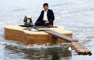 Illustration for article titled Josh Pyke's Guitar Boat Floats on an Ocean of Rock