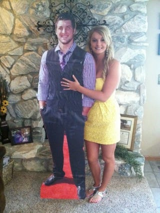 Illustration for article titled Iowa Girl Takes Life-Sized Cardboard Cutout Of Tim Tebow To Prom
