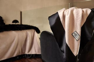 Illustration for article titled Behold Beauty in a Black. Now Voyager Luxury Throw Blanket