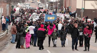 People participate in a national mile-long march to highlight the push for clean water in Flint, Mich., on Feb. 19, 2016.Bill Pugliano/Getty Images