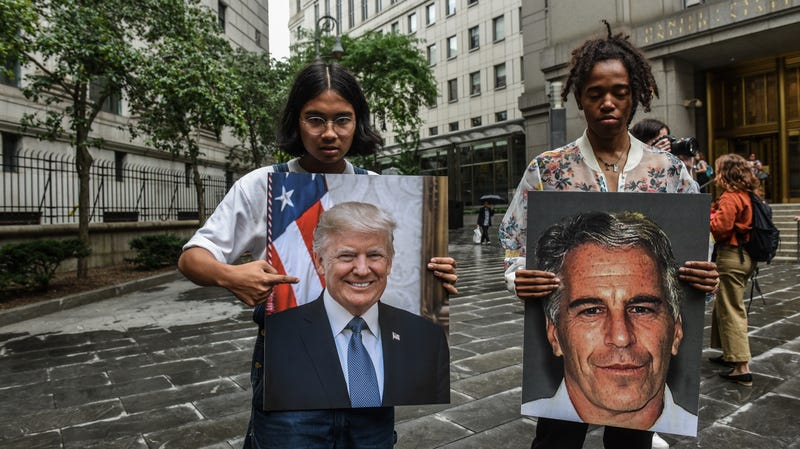 Protesters hold signs of Jeffrey Epstein and President Donald Trump in front of the Federal courthouse in New York City.