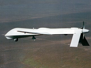 Illustration for article titled Spy Drone Taken Out Of Service After Returning With Creepy Photos Of Insurgents Changing