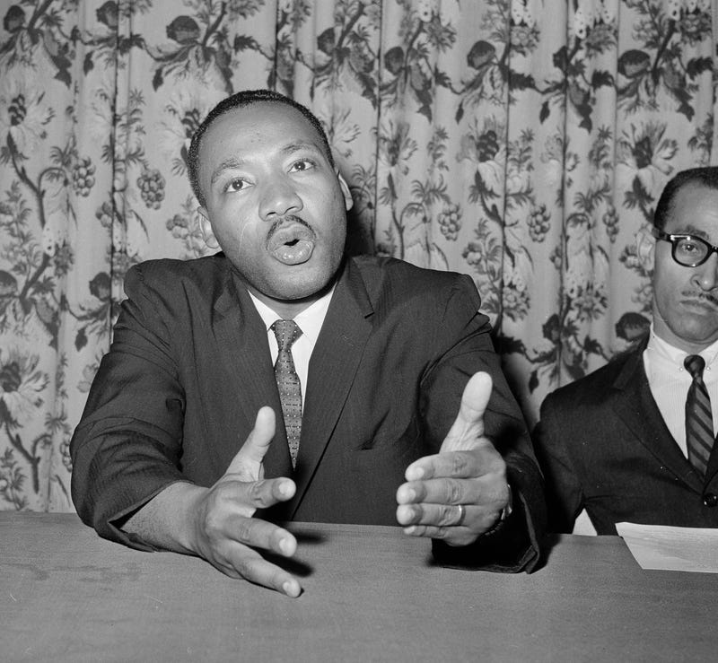 Martin Luther King Jr. asks that then-President John F. Kennedy issue an executive order declaring all forms of racial segregation illegal at a press conference June 5, 1961, in New York. (Associated Press)