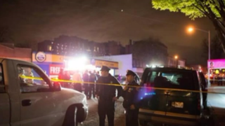 New York City police officers at the scene of the shoot-out that occurred April 27, 2015, after the funeral service for Jose Luis Robles in Brooklyn.YouTube screenshot