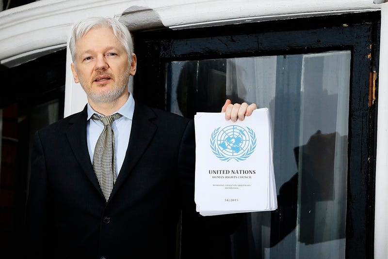 Wikileaks founder Julian Assange speaks on the balcony of the Ecuadorean Embassy in London on February 5, 2016 (AP Photo/Kirsty Wigglesworth)