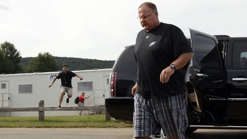 Illustration for article titled Hurry! Andy Reid Is Trying To Get Away!