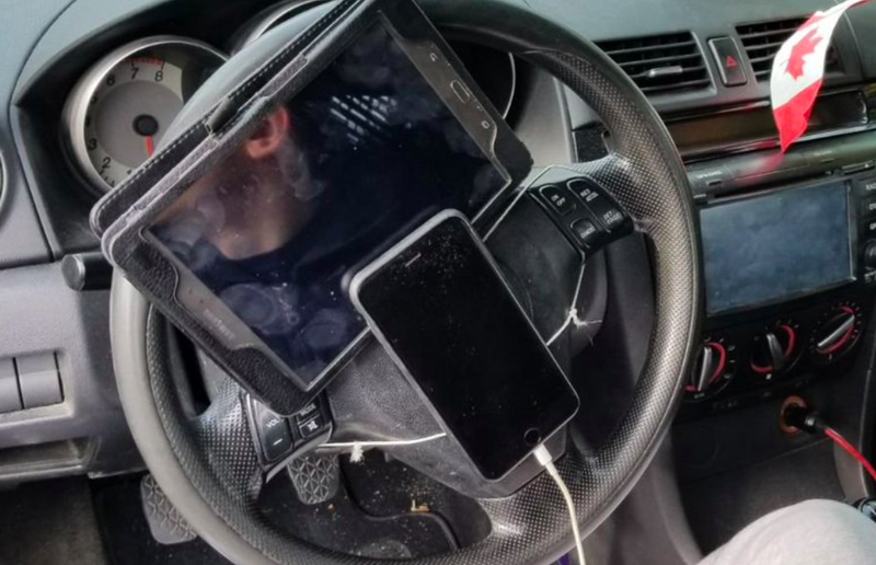 Driver fined after iPhone, tablet tied to steering wheel