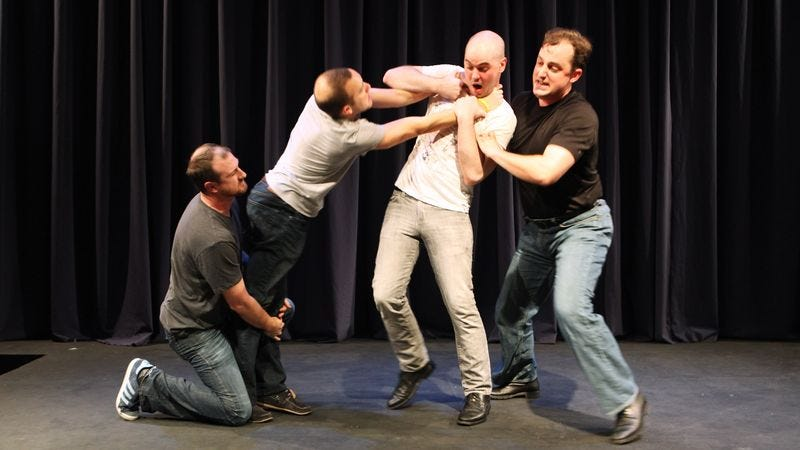 Rapidly balding members of the improv troupe Calhoun.