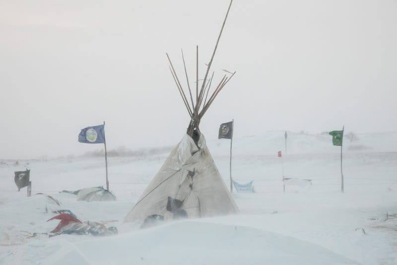 Tipis in the snow at Oceti Sakowin. All photos by Tod Seelie for Jezebel