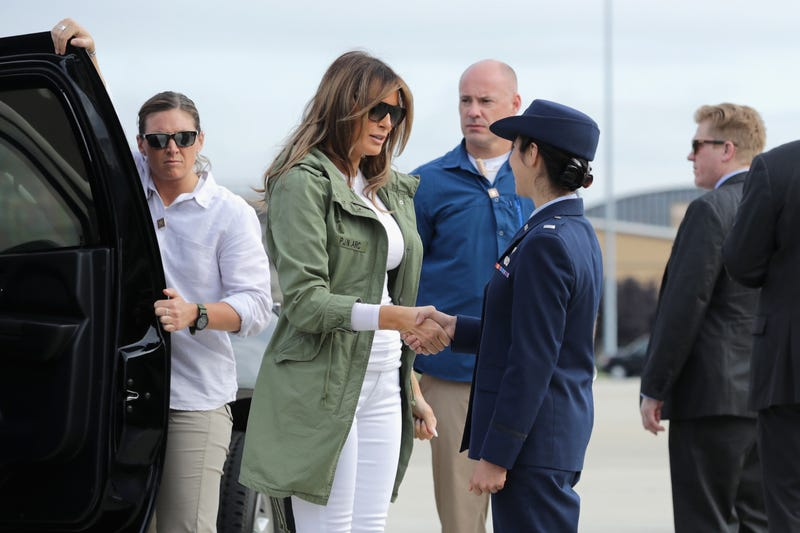 First lady Melania Trump steps out of her motorcade before boarding an Air Force plane and traveling to Texas to visit facilities that house and care for children taken from their parents at the U.S.-Mexico border June 21, 2018, at Joint Base Andrews, Md.