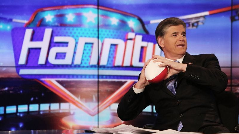 Sean Hannity demonstrates football safety. (Photo: Paul Zimmerman/Getty)