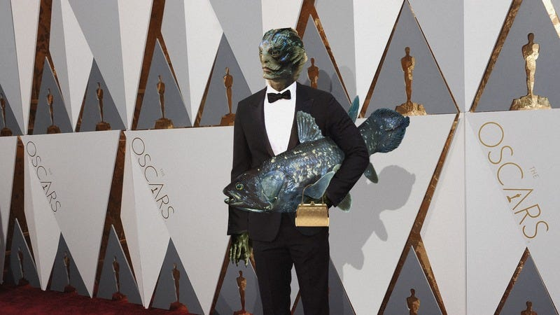 Illustration for article titled Too Cute: The Amphibian Man From 'The Shape Of Water' Brought His Mom To The Oscars And It's Absolutely Adorable