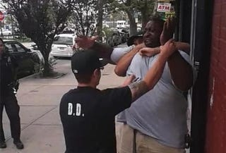 Screenshot of video footage of police trying to handcuff Eric GarnerYouTubes