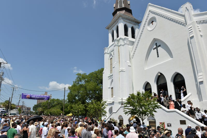 The congregation departs following Sunday services June 21, 2015, at the Emanuel African Methodist Episcopal Church in Charleston, S.C., days after prosecutors say a white supremacist gunned down nine parishioners during Bible study at the historic black church. MLADEN ANTONOV/AFP/Getty Images