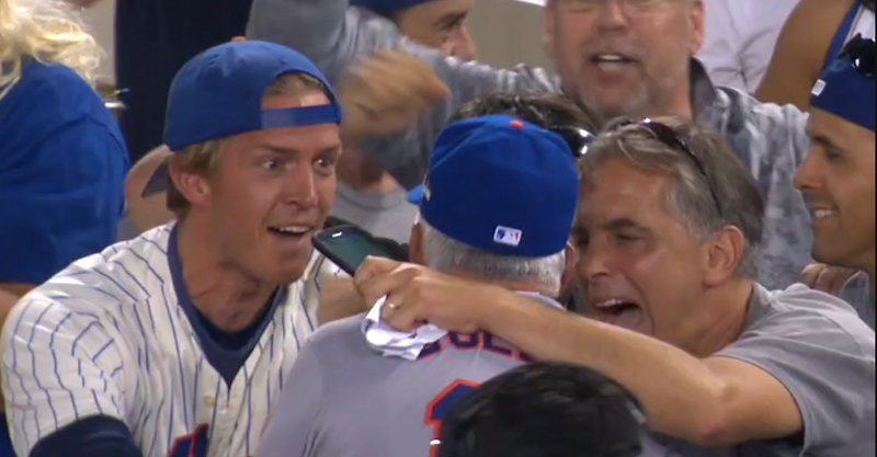 Illustration for article titled Ecstatic Mets Fan Gives Terry Collins A Big Ol' Smooch