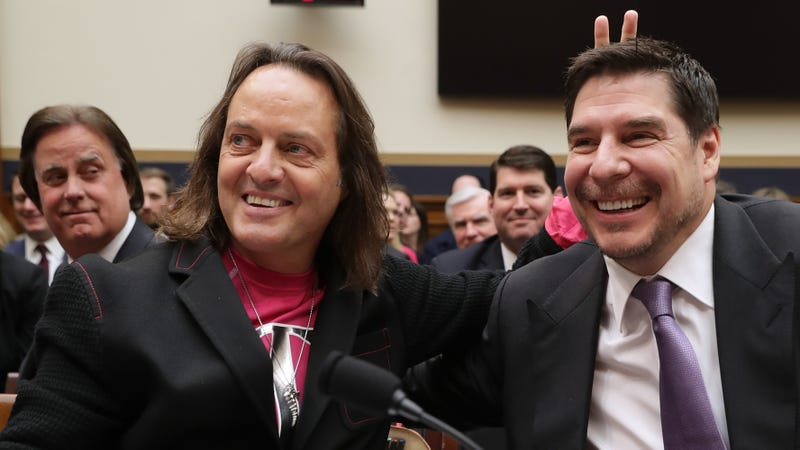 T-Mobile CEO John Legere and Executive Director of Sprint Marcelo Claure pose for photographs before testifying to the House Judiciary Committee's Antitrust, Commercial and Administrative Law Subcommittee on Capitol Hill, March 12, 2019 in Washington, DC.