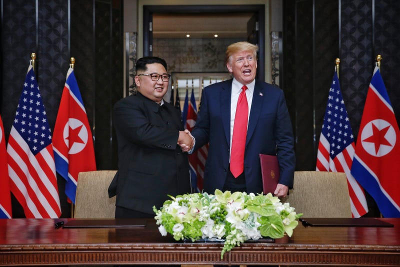 North Korean leader Kim Jong Un with President Donald Trump during their historic summit in Singapore on June 12, 2018