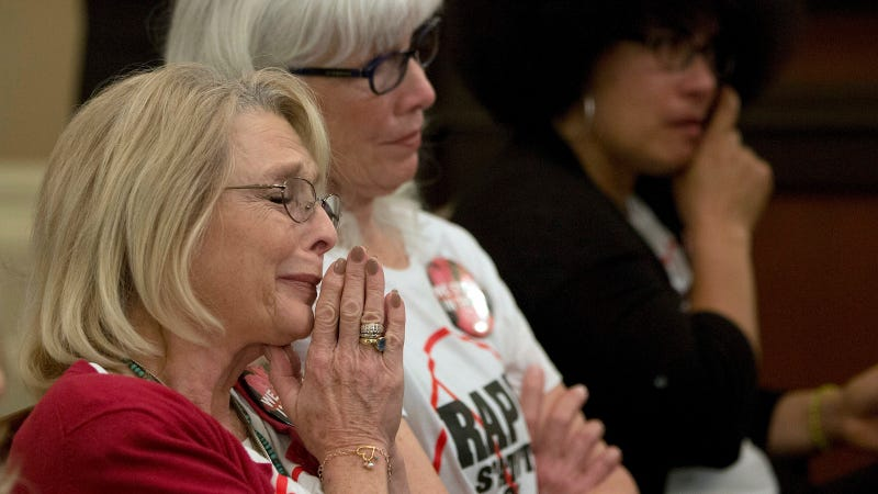 Victoria Valentino, left, who accused Bill Cosby of raping her over 40 years ago, listens to lawmakers discuss the statute of limitations in Sacramento. Image via AP.