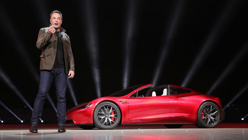 Elon Musk with Tesla's new Roadster, which he hopes to start making in the next few years.
